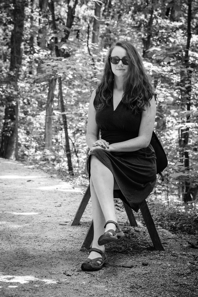Kate, sitting on a bench in Monticello.