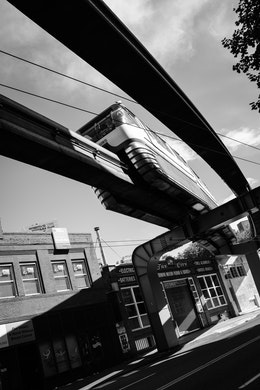 A monorail going over 5th Avenue in Seattle.