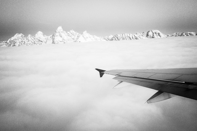 The Teton range, seen above the clouds from a plane departing Jackson Hole Airport.