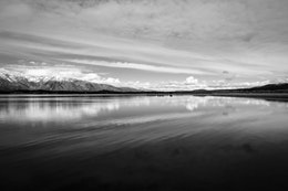 The sky and the Tetons reflected off the surface of Jackson Lake.