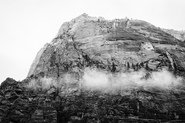 The Great White Throne, seen from the Kayenta Trail, with some fog clinging to its wall.