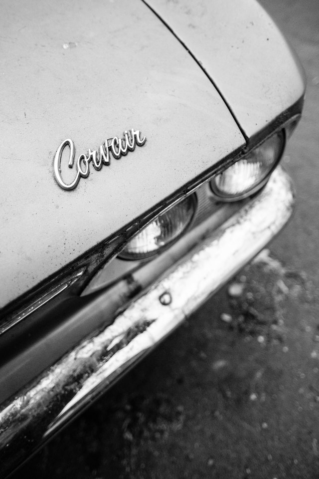 Close up of the badge on the hood of a Chevrolet Corvair parked near Eastern Market in Washington, DC.