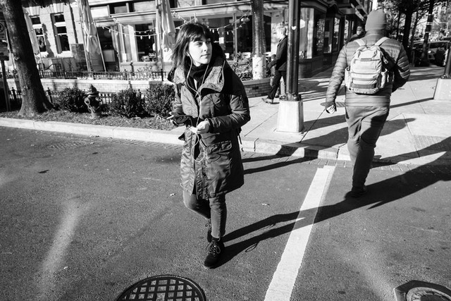 A woman crossing the street near 14th Street NW/