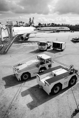 A couple of tugs next to a gate at Orlando International Airport.