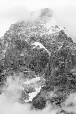 Grand Teton, partially covered by clouds, and sporting a fresh dusting of snow near its summit, the first of the season.