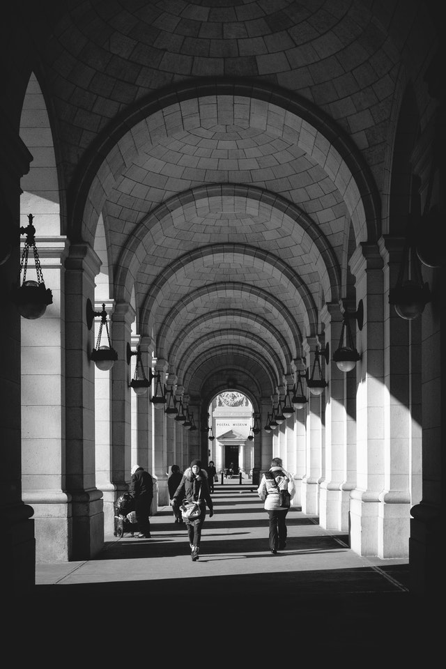 People walking under the arches of Union Station.