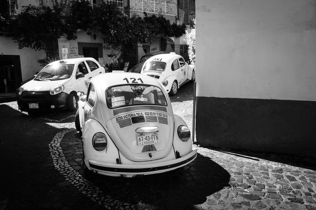 A line of VW taxis turning a corner in Taxco.