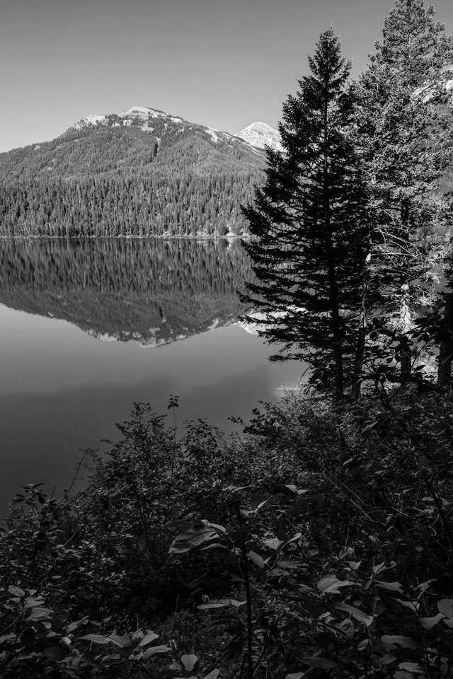 Mountains in the Teton Range, seen reflected off the surface of Phelps Lake, from the Phelps Lake Loop trail.