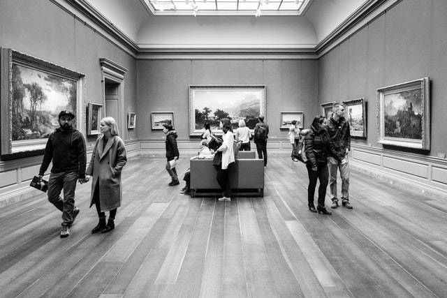 People watching art at the west building of the National Gallery of Art.