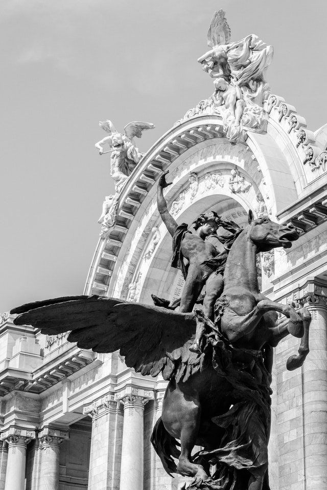 One of the statues in front of the Palacio de Bellas Artes in Mexico City.