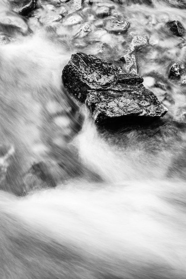 Water flowing over a rock at Cascade Creek.