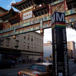 A Metro Station sign in front of the Friendship Arch in Chinatown.