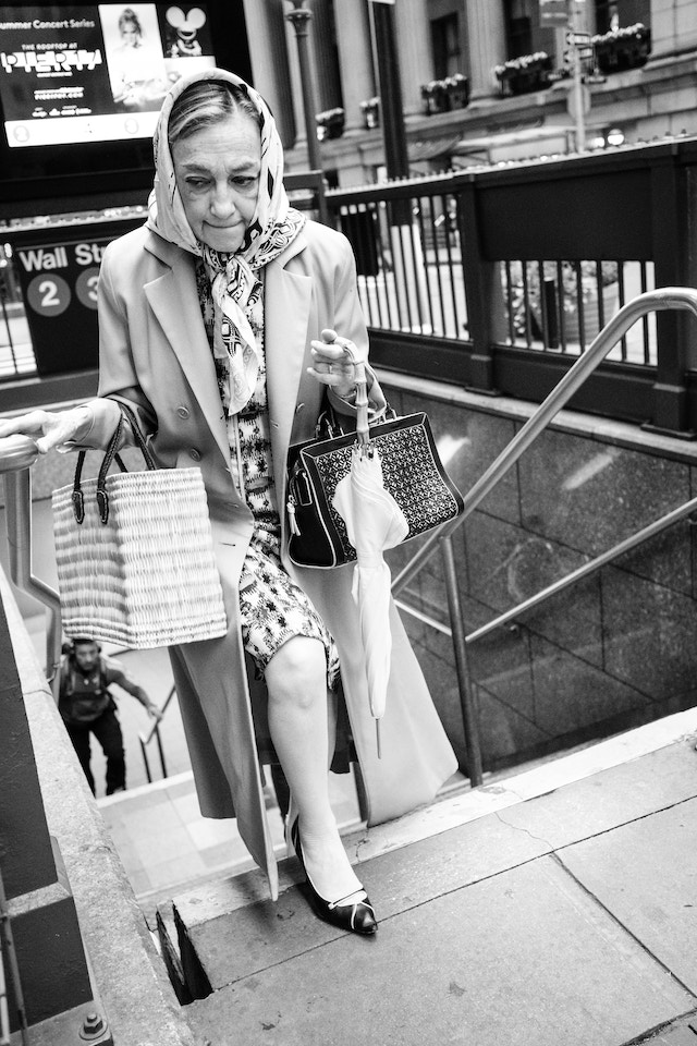 A woman in a headscarf leaving the Wall Street subway station in New York.