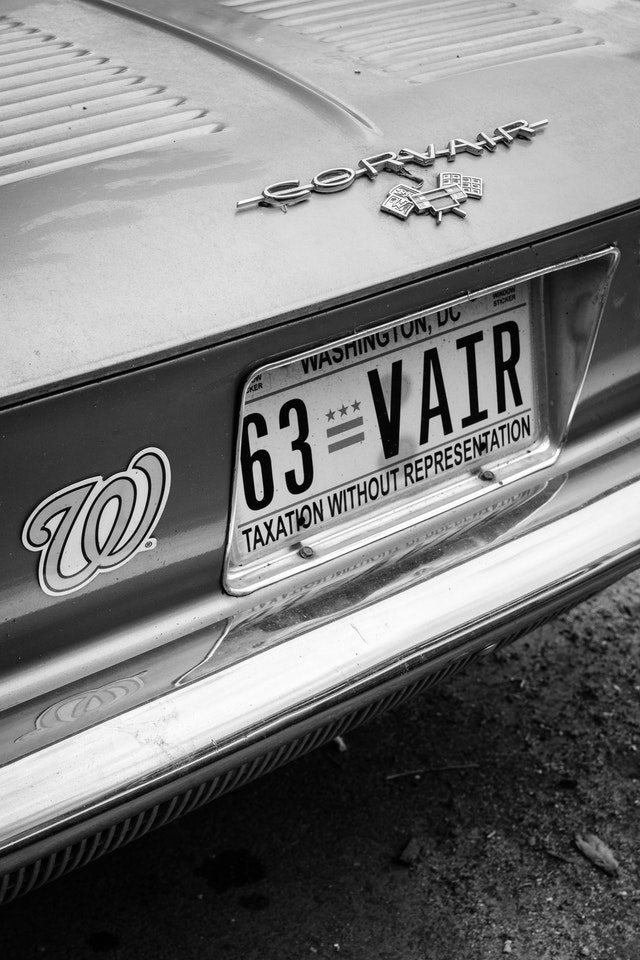 The rear end of a 1963 Convair with DC plates and a Washington Nationals magnet.