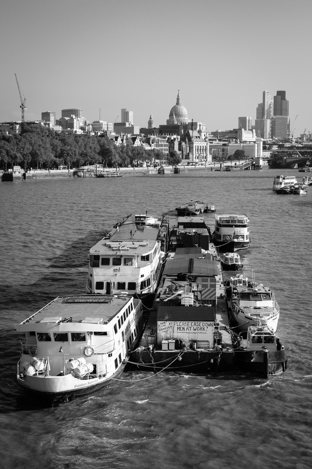 A group of barges on the river Thames.