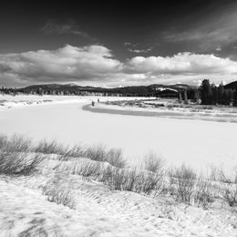 A frozen, snow-covered Snake River, seen from Oxbow Bend.