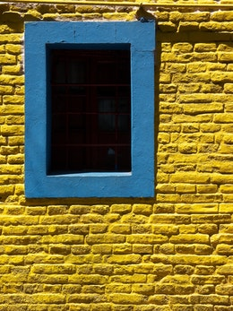 A colorful blue and yellow window in Caminito.