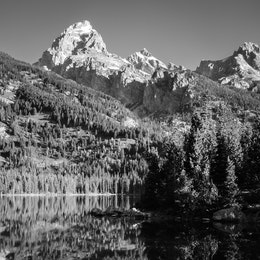 Grand Teton reflected off the waters of Taggart Lake.