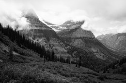 Mount Oberlin, with its summit surrounded in swirling clounds, as seen from the Going-to-the-Sun Road.