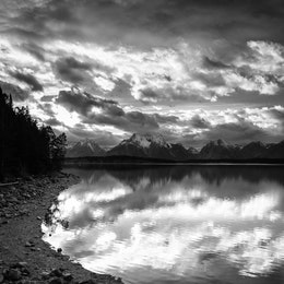 The shore of Jackson Lake, with Mount Moran in the background, at sunset.