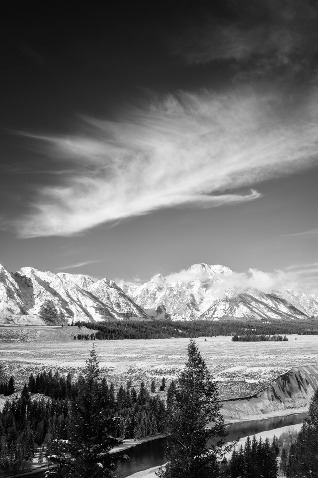 Mount Moran and the Snake River, with some wispy clouds overhead, from the Snake River Overlook.