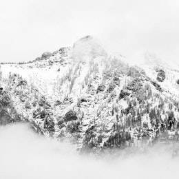 Buck Mountain, covered in fresh snow and surrounded by clouds.