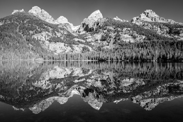 From left to right, Nez Perce, Middle Teton, Grand Teton, and Teewinot, reflected off the waters of Bradley Lake.