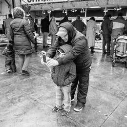 A man and a child taking a selfie at the Maine Avenue Fish Market.