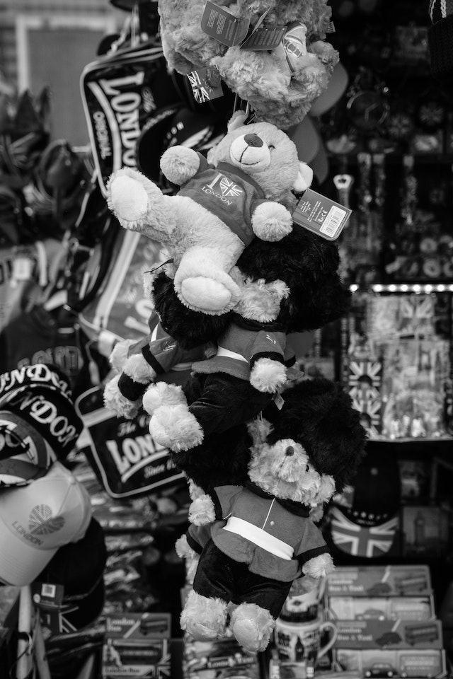 Teddy bears hanging at a souvenir stand on Westminster Bridge.