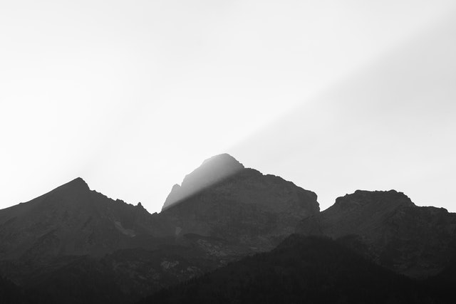 Buck Mountain, at sunset. A streak of sunlight is visible in the smoke.