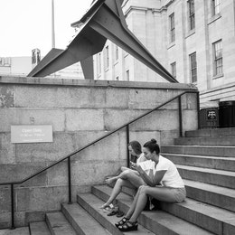 People sitting on the steps outside the National Portrait Gallery in DC.