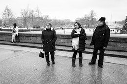 Tourists looking at the Capitol building on a snowy day in DC.