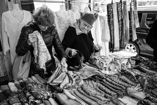 Two women looking at clothes at Eastern Market.