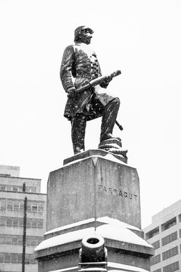 Snow-covered statue of David G. Farragut at Farragut Square.