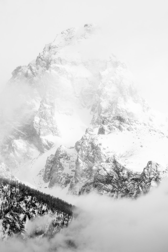 Grand Teton, shrouded in clouds.
