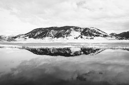 Mountains reflected off the waters of Flat Creek at the National Elk Refuge in Wyoming.