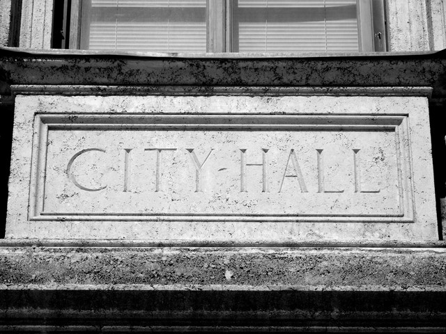 "A ""City-Hall"" sign at the Coral Gables City Hall."