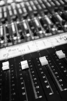Close-up of sliders on a recording console at London Bridge Studio in Shoreline, Washington.