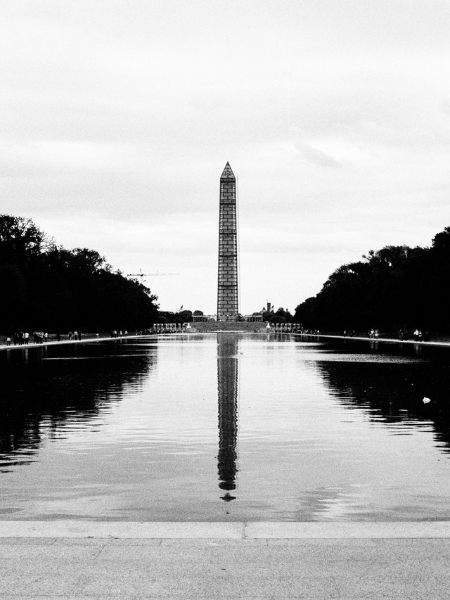 The Reflecting Pool and the Washington Monument covered in scaffolding.