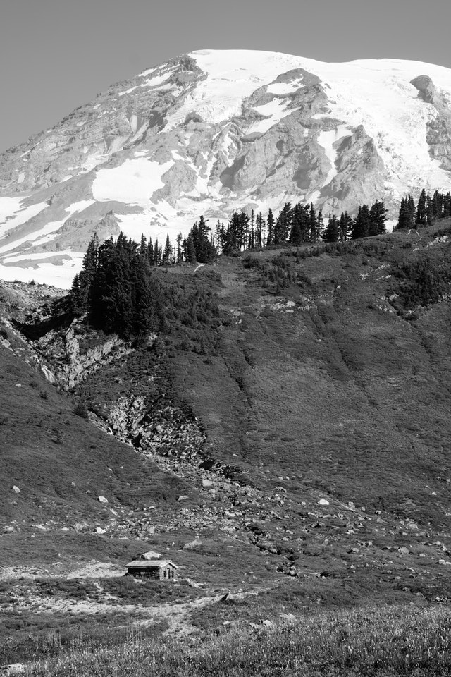 The Edith Creek Chlorination House near the Golden Gate Trail in Mount Rainier National Park, with Mount Rainier in the background behind a ridge.