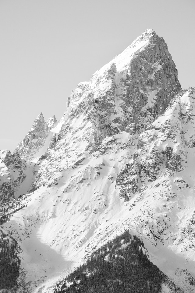 The snow-covered summit of Grand Teton, from the Snake River Overlook.