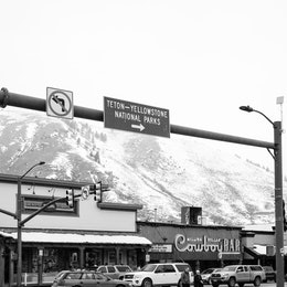 """A street sign reading """"Teton-Yellowstone National Parks"""" at a street in Jackson, Wyoming."""
