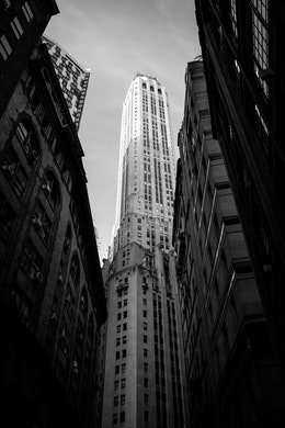 Looking up at 20 Exchange Place from William Street in the Financial District of New York.
