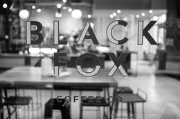 The sign on the window of the Black Fox Coffee Co.