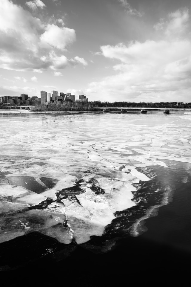 The Rosslyn skyline, in front of a frozen Potomac River, from the Arlington Memorial Bridge.