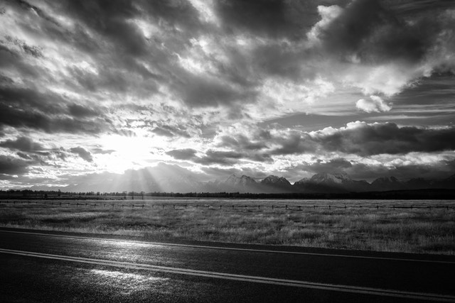 The landscape near the Elk Ranch, with the Teton range in the background, at sunset.