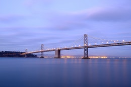 The San Francisco-Oakland Bay Bridge at dusk, from the Embarcadero.
