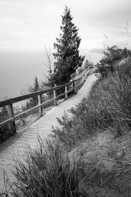 The wooden trail near the top of Empire Bluff, with Lake Michigan and Sleeping Bear Dunes in the background.