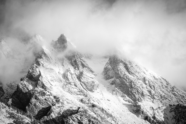 Mount Moran, shrouded in clouds after an early autumn snowfall.