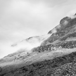 Clouds rolling over the mountains in Glen Coe, Scotland.